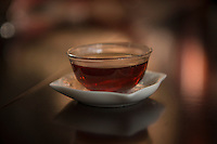 Black tea, Puer-tea shop, Jinghong, Yunnan, China. 11 November 2012.