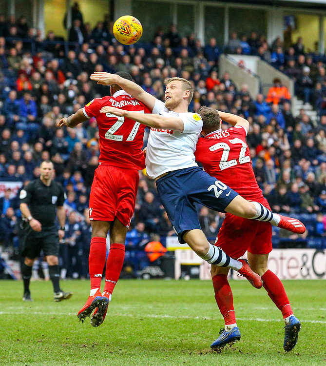 Preston North End's Jayden Stockley competes with Nottingham Forest's Tendayi Darikwa and Ryan Yates<br /> <br /> Photographer Alex Dodd/CameraSport<br /> <br /> The EFL Sky Bet Championship - Preston North End v Nottingham Forest - Saturday 16th February 2019 - Deepdale Stadium - Preston<br /> <br /> World Copyright © 2019 CameraSport. All rights reserved. 43 Linden Ave. Countesthorpe. Leicester. England. LE8 5PG - Tel: +44 (0) 116 277 4147 - admin@camerasport.com - www.camerasport.com