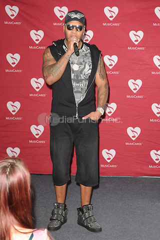 FORT LAUDERDALE, FL - NOVEMBER 22: Flo Rida performs during Music Cares Addiction Recovery Programs at Recovery Unplugged on November 22, 2016 in Fort Lauderdale, Florida. Credit: mpi04/MediaPunch