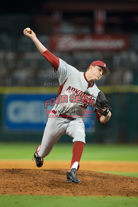 Arkansas Razorbacks relief pitcher Zach Jackson (32) in action against the Rice Owls in game three of the 2016 Shriners Hospitals for Children College Classic at Minute Maid Park on February 26, 2016 in Houston, Texas.  The Razorbacks defeated the Owls 5-2.  (Brian Westerholt/Four Seam Images)