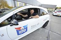 IJSHOCKEY: HEERENVEEN: Uitreiking sponsorauto's bij Opel dealer Siton in Heerenveen aan een selectie van ijshockeyspelers en de coach van de UNIS Flyers, Marco Postma in zijn nieuwe auto, ©foto Martin de Jong