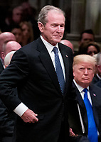 Former President George W. Bush walks past President Donald Trump to speak a State Funeral for President George H.W. Bush, at the National Cathedral, Wednesday, Dec. 5, 2018, in Washington. <br /> CAP/MPI/RS<br /> &copy;RS/MPI/Capital Pictures