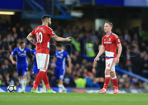May 8th 2017, Stamford Bridge, Chelsea, London England; EPL Premier League football, Chelsea FC versus Middlesbrough; Alvaro Negredo of Middlesbrough arguing with Adam Forshaw of Middlesbrough after Marco Alonso of Chelsea celebrates scoring his teams 2nd goal in the 33rd minute to make it 2-0