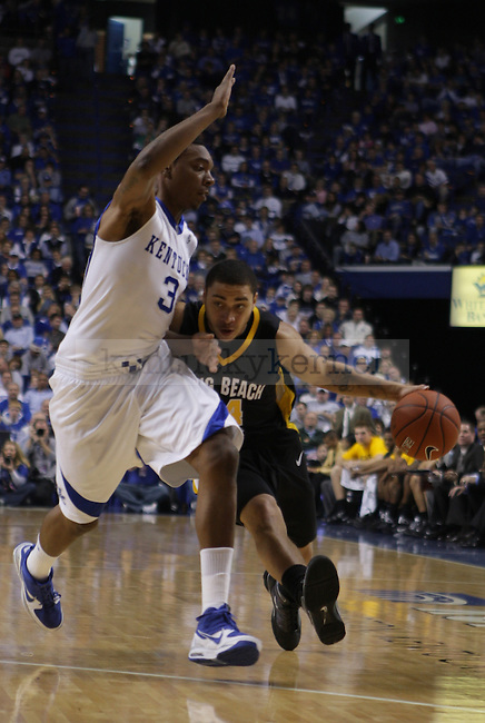 University of Kentucky sophomore guard Darnell Dodson guards Long Beach State's Jesse Woodard in the first half of UK's 86-73 win over Long Beach State in Rupp Arena on Wednesday, Dec., 23, 2009. ..Photo by Ed Matthews | Staff