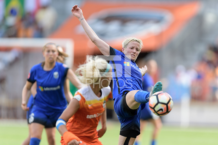 Houston, TX - Saturday May 27, 2017: Megan Rapinoe (15) of the Seattle Reign FC reaches for the ball against the Houston Dash during a regular season National Women's Soccer League (NWSL) match between the Houston Dash and the Seattle Reign FC at BBVA Compass Stadium.