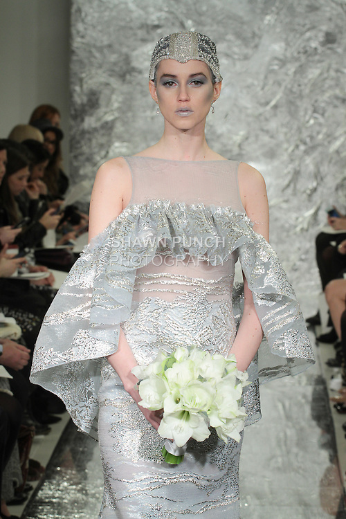 Model Caitlin Lyon walks runway in Aura - a galactic blue silke lamé jacquard bridal gown with ruffle, from the Theia Spring 2017 bridal collection by Don O'Neill, during New York Bridal Fashion Week Spring Summer 2017 on April 14, 2016.