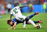 (180624) -- YEKATERINBURG, June 24, 2018 -- Genki Haraguchi (bottom) of Japan vies with Youssouf Sabaly of Senegal during the 2018 FIFA World Cup WM Weltmeisterschaft Fussball Group H match between Japan and Senegal in Yekaterinburg, Russia, June 24, 2018. ) (SP)RUSSIA-YEKATERINBURG-2018 WORLD CUP-GROUP H-JAPAN VS SENEGAL LiuxDawei PUBLICATIONxNOTxINxCHN  <br /> YEKATERINBURG 24-06-2018 Football FIFA World Cup Russia  2018 <br /> Japan - Senegal / Giappone - Senegal<br /> Foto Xinhua/Imago/Insidefoto