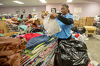 NWA Media/JASON IVESTER --12/18/2014--<br /> Georgia McWilliams helps sort through donations on Thursday, Dec. 18, 2014, inside Helping Hands in Bentonville. Employees and volunteers are preparing for their annual Christmas meal distribution.