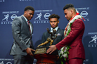 New York, NY - December 8, 2018:  Dwayne Haskins, Kyler Murray and Tua Tagovailoa pose with the Heisman Trophy after speaking to the media at the New York Marriott hotel December 8, 2018.  (Photo by Don Baxter/Media Images International)