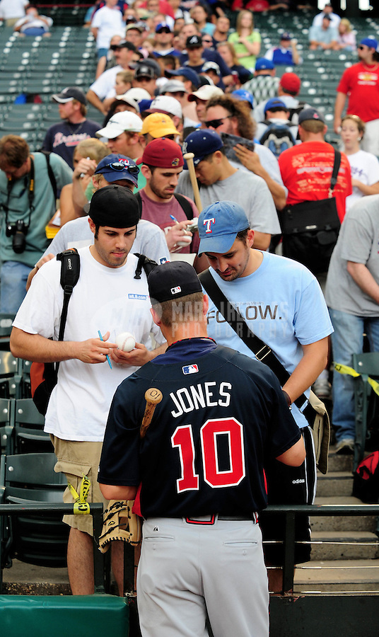 Jun. 17, 2008; Arlington, TX, USA; Fans line up to get an autograph from Atlanta Braves designated hitter Chipper Jones prior to the game against the Texas Rangers at the Rangers Ballpark. Mandatory Credit: Mark J. Rebilas-
