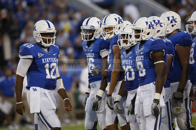 Junior quarterback Morgan Newton talks with his team in a huddle during the first half of UK's home game against Florida, Saturday, Sept. 24, 2011 in Lexington, Ky.  Photo by Brandon Goodwin | Staff
