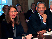 United States President Barack Obama meets with his Cabinet in the Cabinet Room of the White House in Washington, D.C. on Friday, November 7, 2014. From left to right: Secretary of Health and Human Services Sylvia Mathews Burwell, President Obama.  The President is pictured reacting to a question asked by CBS Radio reporter Mark Knoeller.<br /> Credit: Dennis Brack / Pool via CNP