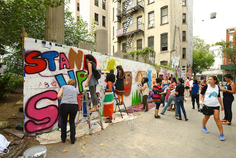 A group effort creating a mural at First Street Green Art Park on the Lower East Side.
