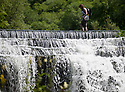 22/07/14 <br /> <br /> A walker crosses Monsal Weir, near Bakewell in the Derbyshire Peak District.<br /> All Rights Reserved - F Stop Press.  www.fstoppress.com. Tel: +44 (0)1335 300098