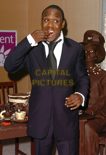 MOHAMMED GEORGE.The Chocolate Ball,.The Dorchester, London, England, .March 24th 2006..half length eating funny.Ref: CAN.www.capitalpictures.com.sales@capitalpictures.com.©Capital Pictures