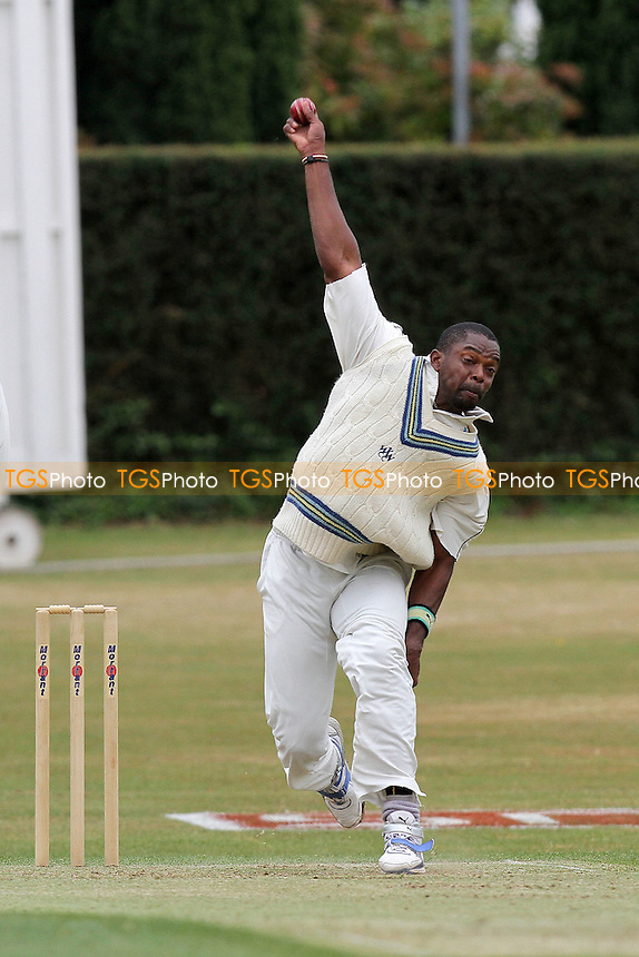Andrew Richardson in bowling action for Woodford Wells - Woodford Wells CC (fielding) vs Ilford CC - Essex Cricket League - 28/05/11 - MANDATORY CREDIT: Gavin Ellis/TGSPHOTO - Self billing applies where appropriate - Tel: 0845 094 6026