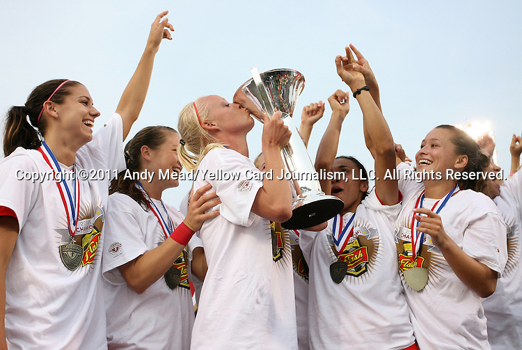 27 August 2011: New York captain Caroline Seger (SWE) kisses the cup as Alex Morgan (left), Brittany Bock, Marta (BRA), and Ali Riley watch. Western New York Flash defeated the Philadelphia Independence 5-4 on penalty kicks to win the final after the game ended in a 1-1 tie after overtime at Sahlen's Stadium in Rochester, New York in the Women's Professional Soccer championship game.