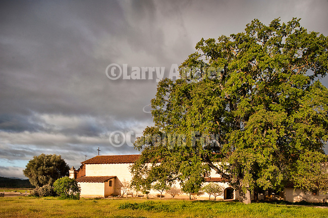 Exterior of main chapel, heritage oak, Mission San Antonio de Padua, California.