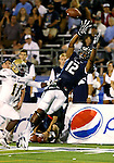 Nevada's Hasaan Henderson goes up for a catch against UC Davis defender Jonathan Perkins during the second half of a college football game in Reno, Nev., on Saturday, Sept. 7, 2013. (AP Photo/Cathleen Allison)