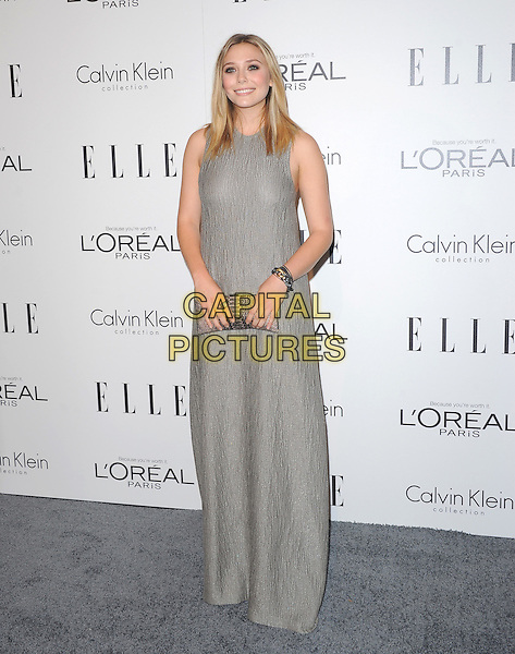 Elizabeth Olsen.18th Annual ELLE Women in Hollywood celebration held at The Four Seasons in Beverly Hills, California, USA..October 17th, 2011.full length dress grey gray maxi clutch bag sleeveless .CAP/RKE/DVS.©DVS/RockinExposures/Capital Pictures.