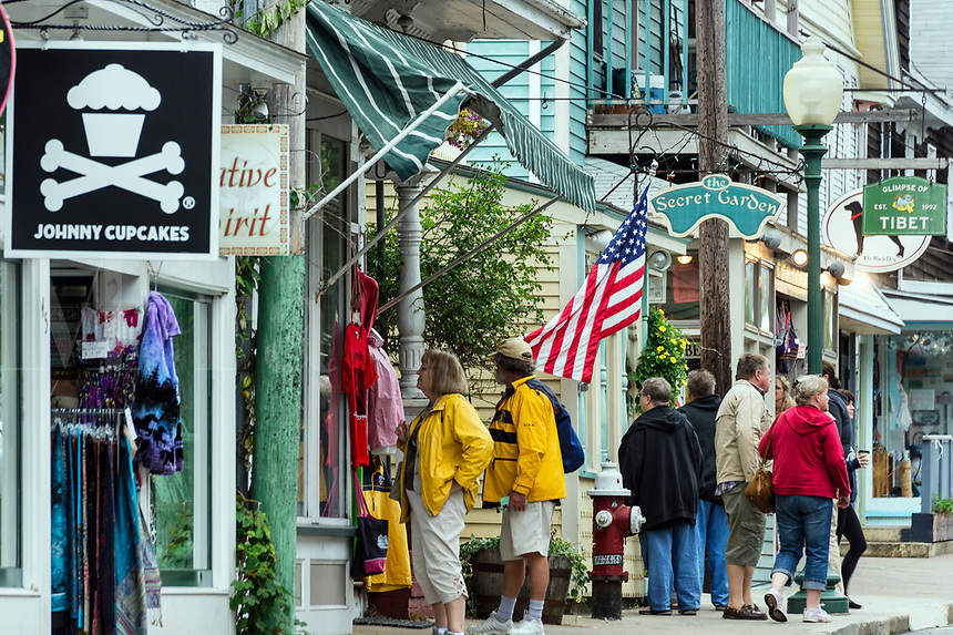 Tourists explore the charming shops of Oak Bluffs, Marthas Vineyard, Massachusetts, USA.