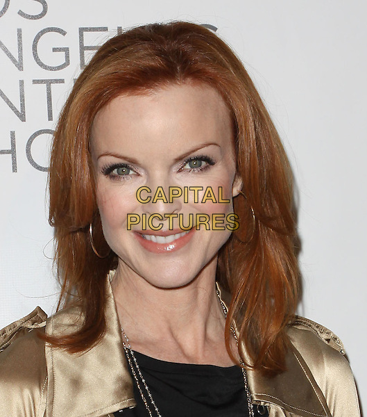 MARCIA CROSS.Opening Night Preview Party of the LA Antique Show Benefiting P.S ARTS held At The Barker Hanger, Santa Monica, California, USA..April 21st, 2010.headshot portrait gold hoop earrings make-up black necklace .CAP/ADM/KB.©Kevan Brooks/AdMedia/Capital Pictures.