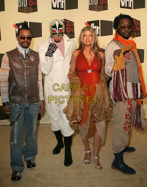 BLACK EYED PEAS - APL.DE.AP, TABOO, FERGIE & WIL.I.AM.The VH1 Big in 04  Award Show held at The Shrine Auditorium in Los Angeles, California .December 1, 2004.full length, sunglasses, shades, mask, dress-up, costume, scarf, fur wrap, vest.www.capitalpictures.com.sales@capitalpictures.com.Supplied by Capital Pictures