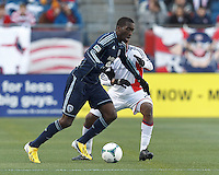 Sporting Kansas City midfielder C.J. Sapong (17) dribbles.  In a Major League Soccer (MLS) match, Sporting Kansas City (blue) tied the New England Revolution (white), 0-0, at Gillette Stadium on March 23, 2013.