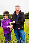 Mike O'Connor(MOC Tyres) presenting Ellie Cournane with a cup for finishing first on Donkey Kong in Donkey Derby at the Cahersiveen Races on Sunday.