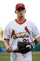 Ryan Jackson (23) of the Springfield Cardinals walks back to the dugout during a game against the Tulsa Drillers at Hammons Field on July 19, 2011 in Springfield, Missouri. Tulsa defeated Springfield 17-11. (David Welker / Four Seam Images)