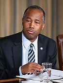"United States Secretary of Housing and Urban Development (HUD) Ben Carson makes remarks as First lady Melania Trump hosts a meeting of the Interagency Working Group on Youth Programs in the State Dining Room of the White House in Washington, DC on Monday, March 18, 2019.  The group was originally established under former United States President George W. Bush and is part of an effort to align the First Lady's ""Be Best"" initiative with the working group. <br /> Credit: Ron Sachs / CNP"