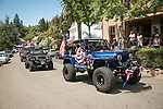 Motherlode Rock Crawlers 4wd group with jazzed-up jeeps. Downtown main street during the Independence Day celebration Main Street, Mokelumne Hill, California