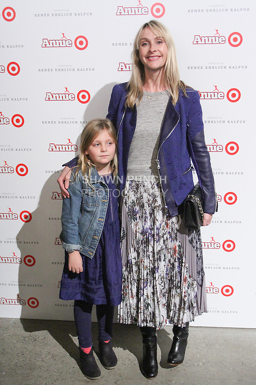 Rebecca Taylor and child arrive at the Annie For Target collection celebration and pop-up shop at Stage 37 in New York City on November 4, 2014.