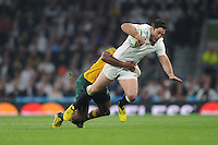 Brad Barritt of England is tackled by Tevita Kuridrani of Australia during Match 26 of the Rugby World Cup 2015 between England and Australia - 03/10/2015 - Twickenham Stadium, London<br /> Mandatory Credit: Rob Munro/Stewart Communications