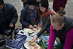 Volunteer Monique Fritsche (centre) preparing food as part of the We Picknick group which distributes food to newly-arrived refugees in Berlin. The volunteer initiative was one of many initiated by citizens of the city to help refugees. Around 60,000 refugees arrived in the city in the first 10 months of 2015, out of an overall total of around 850,000 in the whole of Germany.