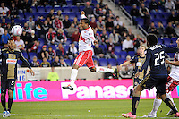 Dane Richards (19) of the New York Red Bulls heads the ball as the New York Red Bulls score during a Major League Soccer (MLS) match against the Philadelphia Union at Red Bull Arena in Harrison, NJ, on October 20, 2011.