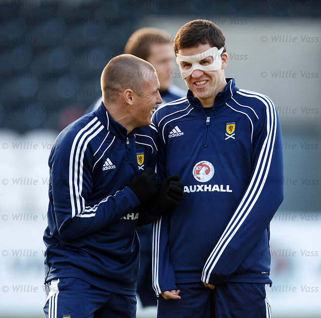 Kenny Miller laughing at Gary Caldwell's face mask at training