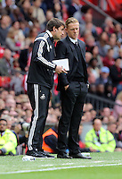 """Pictured L-R: Josep """"Pep"""" Clotet and manager Garry Monk of Swansea.  Saturday 16 August 2014<br /> Re: Premier League Manchester United v Swansea City FC at the Old Trafford, Manchester, UK."""