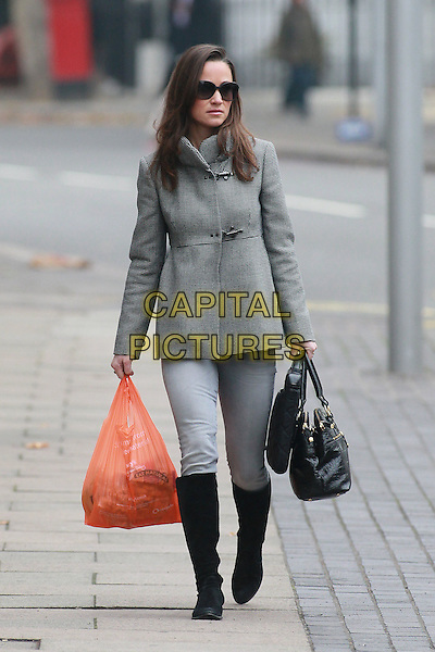 Pippa Middleton arrives for work, London, England..November 21st, 2011.full length sunglasses shades grey gray coat jacket jeans denim black boots bag purse orange sainsbury's shopping carrier bag.CAP/HIL.©John Hillcoat/Capital Pictures .