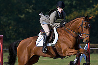 Horse and rider showjumping in equestrian competition, Oxfordshire, United Kingdom