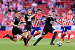 Angel Correa of Atletico de Madrid (C) fights for the ball with Dani Garcia Carrillo (L) and Gonzalo Escalante of SD Eibar (R) during the La Liga match between Atletico Madrid and Eibar at Wanda Metropolitano Stadium on May 20, 2018 in Madrid, Spain. Photo by Diego Souto / Power Sport Images