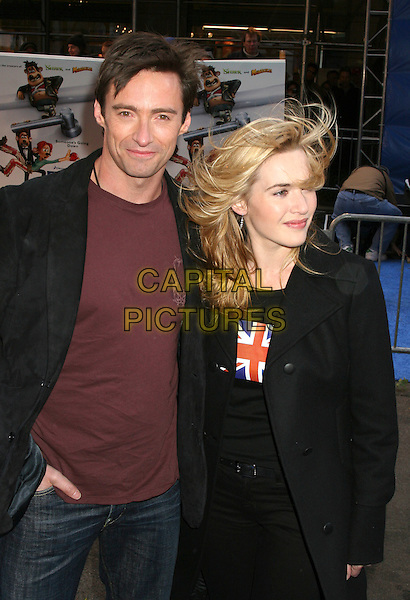 "HUGH JACKMAN & KATE WINSLET.Arrivals at the ""Flushed Away"" Premiere, held at the AMC Lincoln Square, New York, NY, USA, 29 October 2006..half length hair blowing in wind messy windy funny.Ref: IW.www.capitalpictures.com.sales@capitalpictures.com.©Ian Wilson/Capital Pictures"