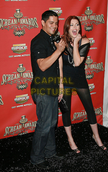 "JAY HERNANDEZ & DIORA BAIRD.At Spike TV's ""Scream Awards 2006"", Press Room,. at the Pantages Theatre, Hollywood, California, USA, .7th October 2006..full length.Ref: ADM/ZL.www.capitalpictures.com.sales@capitalpictures.com.©Zach Lipp/AdMedia/Capital Pictures."