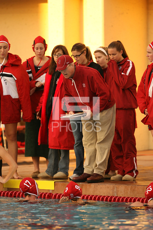 2 February 2007: John Tanner talks with Jessica Steffens and Kira Hillman during Stanford's 10-6 win over Hawaii at the Avery Aquatic Center in Stanford, CA.