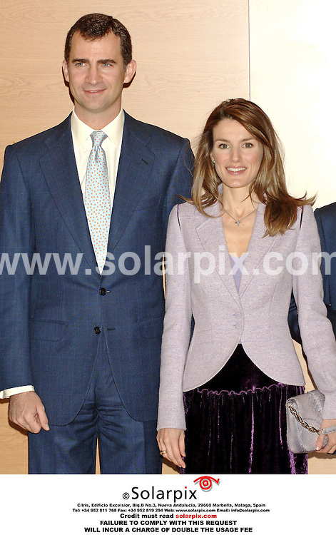 "ALL ROUND PICTURES FROM SOLARPIX.COM..Prince Felipe and Princess Letizia of Spain attend the ""Empresas & Sociedad"" Foundation Awards Ceremony in Madrid on 15.03.06.  The Princess was greeted by children from a local blind school who asked if they could touch her face so that they would be able to see how beautiful she is..Princess Letizia wore understated white gold and diamond jewellery including a charm bracelet which incorporated the name of her daughter Leonor.  Job Ref: 2191/SPA..MUST CREDIT SOLARPIX.COM OR DOUBLE FEE WILL BE CHARGED...."