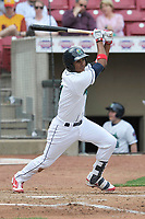 Cedar Rapids Kernels shortstop Jermaine Palacios (4) swings during a game against the Beloit Snappers at Veterans Memorial Stadium on April 9, 2017 in Cedar Rapids, Iowa.  The Kernels won 6-1.  (Dennis Hubbard/Four Seam Images)