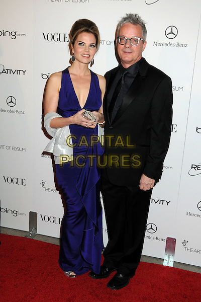 """ANITA MOTHERSBAUGH & MARK MOTHERSBAUGH of DEVO.attends the Art of Elysium 4th Annual Charity Gala """"Heaven"""" held at The Annenberg Building at The California Science Center in Los Angeles, California, USA, January 15th 2011..full length purple dress blue black suit tie glasses .CAP/ADM/BP.©Byron Purvis/AdMedia/Capital Pictures."""