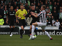 Marc McAusland stops Gary Hooper in the St Mirren v Celtic Clydesdale Bank Scottish Premier League match played at St Mirren Park, Paisley on 20.10.12.