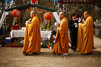 Buddhist monks collect donations during an Asian New Year festival, Sunday, Jan. 25, 2009, at Lien Hoa Vietnamese Buddhist temple in San Antonio. (Darren Abate/pressphotointl.com)