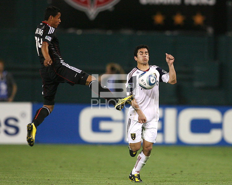 Andy Najar #14 of D.C. United leaps at Tony Beltran #2  of Real Salt Lake during an Open Cup match at RFK Stadium, on June 2 2010 in Washington DC. DC United won 2-1.